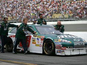 After running out of gas immediately following his hypermiling win, Dale Earnhardt Jr is pushed to the victory lane at the Lifelock 400.