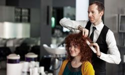 Your hair stylist may love you right back, but he'll also want to protect his business.