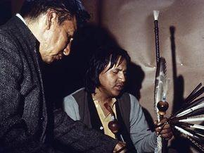 1968: Lakota Sioux medicine man and spiritual leader Leonard Crow Dog during a peyote ceremony on the Rosebud reservation in South Dakota.