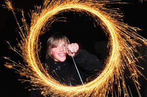 Eleven-year-old Conor Hewitt makes light circles with a sparkler during Bonfire Night celebrations on Nov. 5, 2009 in Brighton, England.