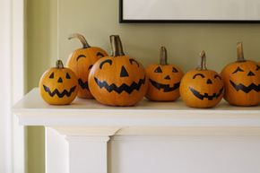 Cover your mantle with friendly pumpkins. Since this kind of jack-o'-lantern involves no carving, kids can tackle it solo. See more Halloween pictures.