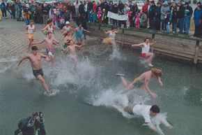 The Popsickos charge into icy Lake Ontario in Canada on Jan. 1. This annual charity swim began as a way of getting over a hangover. It's unlikely that remedy worked.