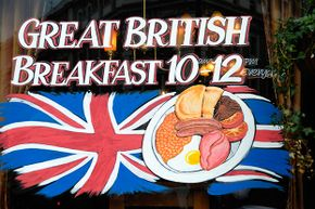 This sign in a British pub advertises a 'Great British Breakfast' featuring lots of protein in the form of bacon, eggs, sausages and beans.