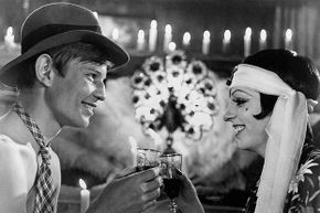 Liza Minnelli and Michael York enjoy some wine in the movie 'Cabaret'. The prairie oyster is sure to follow.
