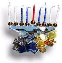 A Hanukiyah surrounded by Hanukkah trinkets: Notice the raised Shamash candle.