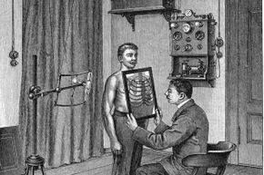 In this illustration from 1903, a doctor  examines a patient's thorax using an X-ray tube and fluorescent screen.  X-rays were discovered in 1895 and immediately used in medicine.