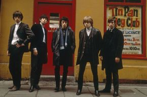 Mick Jagger (extreme left) and Keith Richards (second from left) are show in a 1963 photo of the Rolling Stones; the group was formed after Mick and Keith met by chance in a railway station.