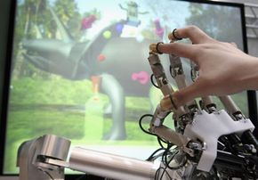 HIRO, a haptic interface robot, helps a user feel a dinosaur during the Prototype Robot Exhibition at the 2005 World Exposition in Japan.