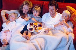 Snacking in front of the TV is often learned from parents.
