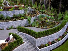 A series of retaining walls correct a large, awkward slope that would otherwise be hard to use or cultivate.