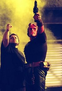 """Left to right: Writer/director Guillermo del Toro and Ron Perlman on the set of """"Hellboy"""""""