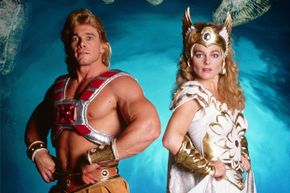 Actors in 1987 portray the characters of He-Man and She-Ra.