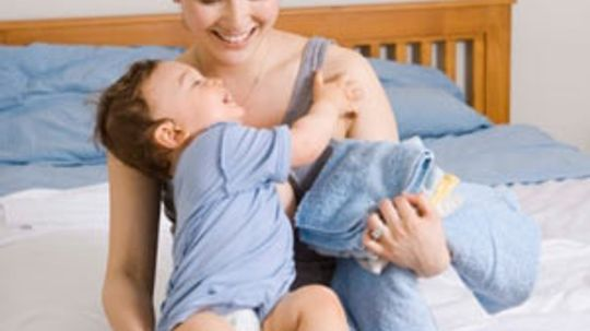 Are high-efficiency (HE) detergents safe for baby clothing?