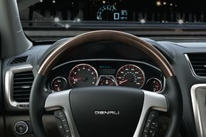 The 2012 GMC Acadia's heads-up display allows drivers to safety merge onto the highway using technology similar to what fighter pilots use to guide precise movements at supersonic speeds. See more car safety pictures.