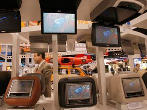 Car headrest and overhead DVD systems by Audiovox are shown at the Consumer Electronics Show (CES) in Las Vegas, Tuesday, Jan. 8, 2008.