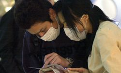 Before seeing a doctor, this Taiwanese couple will need to present their smart cards.