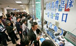 Chinese citizens line up to receive services or pay medical bills at a local hospital.