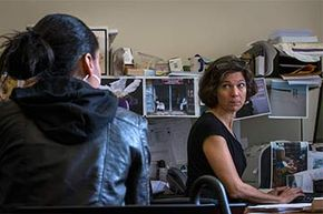 Navigator Elisabeth Benjamin (R) helps a woman find a health care plan at the Community Service Society in New York.