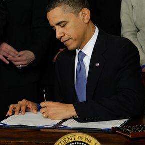 President Barack Obama signs the health care bill. See more Barack Obama pictures.
