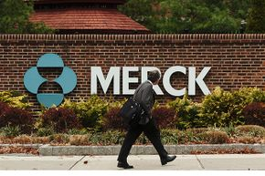 A man walks by a  Merck plant in Rahway, New Jersey in 2005. Drug companies have much higher profit margins than health insurance companies.
