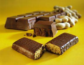 Stack of chocolate coated energy bars.