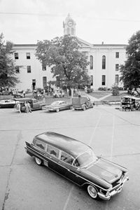 The hearse bearing the body of novelist William Faulkner passes the Lafayette County Courthouse in Oxford, Miss., July 7, 1962.