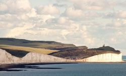 At the far right, you can just see the Belle Tout jutting up from the perilously sharp cliffs in East Sussex.