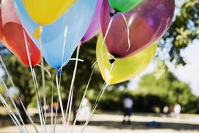 As long as the helium plus the balloon is lighter than the air it displaces, the balloon will float in the air.