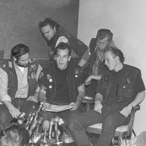 """Ralph """"Sonny"""" Barger (center), president of the Oakland chapter of the Hells Angels, reads a statement during a news conference in Oakland, Calif., on Nov. 19, 1965."""