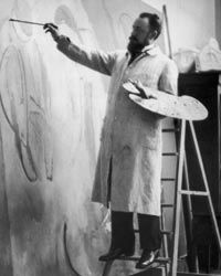 Matisse paints a figure on a large canvas in his studio.