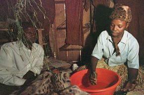 A Ugandi traditional healer prepares a healing compound. While a far cry from the lab, healers like this work with potent chemical compounds.