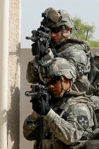 Captain J. Dow Covey and Staff Sergeant Justin Evaristo rely on the Land Warrior system in Mushahidah, Iraq.