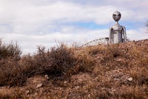 A statue of an alien stands guard over the Nevada highway near the Area 51 base.