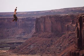Highlining over a canyon in Moab, Utah