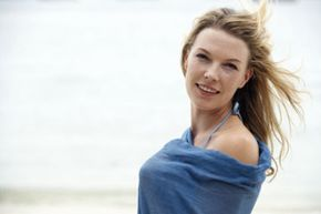 A sarong is beach appropriate and perfect for hiding blemishes.