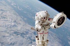 June 2002: Astronaut Franklin R. Chang-Diaz works with a grapple fixture during extravehicular activity to perform work on the International Space Station.