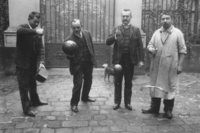 A group of men play cup and ball in 1906.