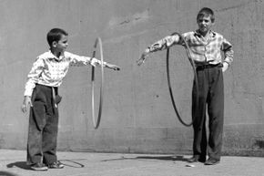 The hoop is a simple toy, but it's been entertaining kids for centuries.