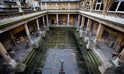 Lady bathers at Roman baths would have worn stylishly minimal bandeaus and briefs -- if they wore anything at all!