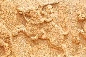 Stone carvings like this one from a temple in India are records of man's warlike past.