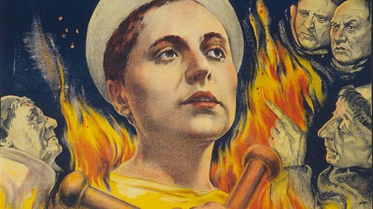 Why was cross-dressing the only crime Joan of Arc was charged with?