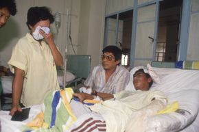 A victim of the 1987 Dona Paz shipwreck lies in a hospital bed.