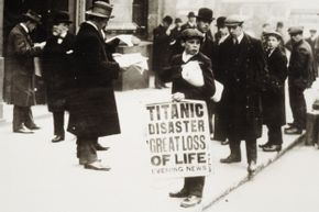 A newsie hawks papers announcing the sinking of the RMS Titanic.