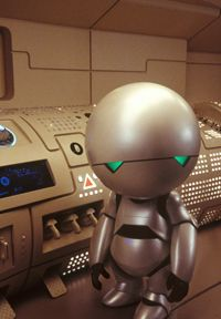 Warwick Davis and Alan Rickman (voice) as Marvin the Paranoid Android