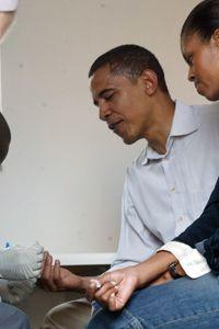 Barack Obama Image Gallery Barack and Michelle Obama have blood drawn for an HIV test in Kenya. See more pictures of Barack Obama.