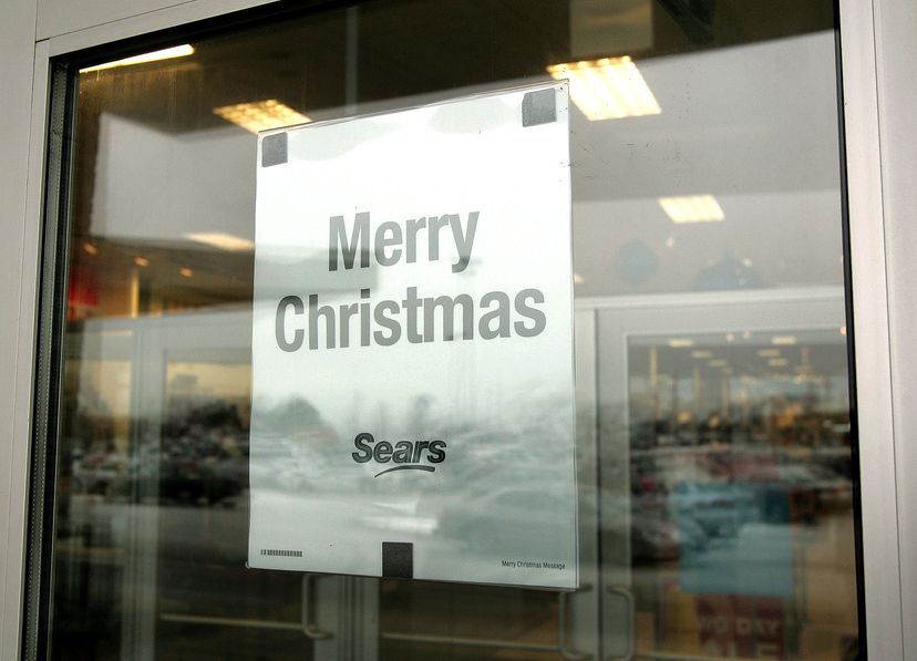 A 'Merry Christmas' sign hangs on the door of a Sears store on Dec. 8, 2005, in Niles, Illinois. Sears put the word 'Christmas' back into some of their holiday promotions after a conservative group voiced their concerns. Tim Boyle/Getty Images