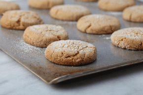 Homemade baked goods -- yes, baked goods! -- can make for a delicious addition to a healthy gift basket, especially when they're made with partly whole-wheat flour.