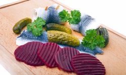 Pickled herring begins the Midsommer feast in Sweden.