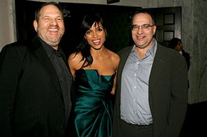 """Filmmaker Michael Moore sued Harvey Weinstein (left) and his brother Bob Weinstein (right) over profits of the film """"Fahrenheit 9/11."""""""