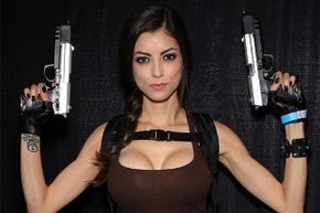 Model LeeAnna Vamp, dressed as the character Lara Croft from the 'Tomb Raider' at Comic Con in 2013. The beautiful babe who can also kick butt is becoming a latter-day cliché.